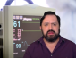 a man in front of a heart monitor on a green screen