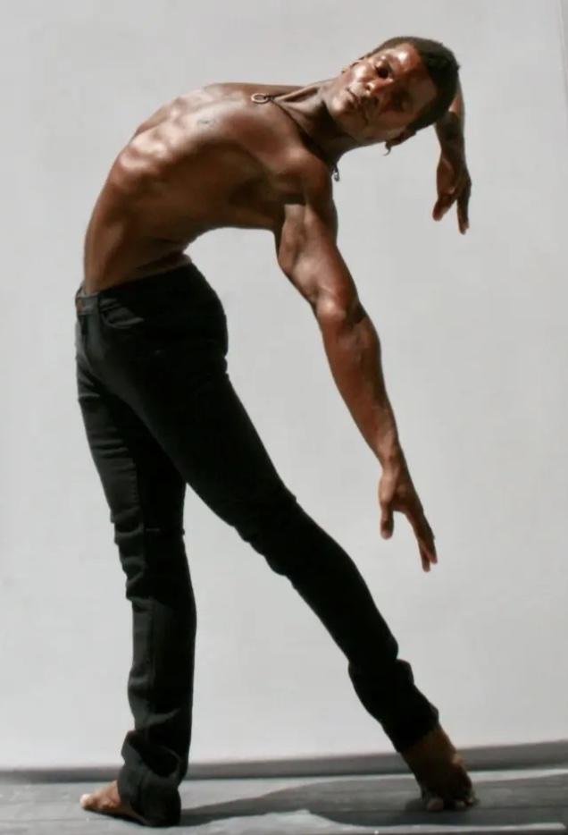 Abdur-Rahim Jackson bending backwards with is arms behind him