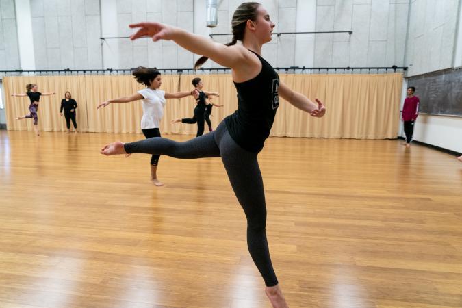 Dancer Leaping in Studio