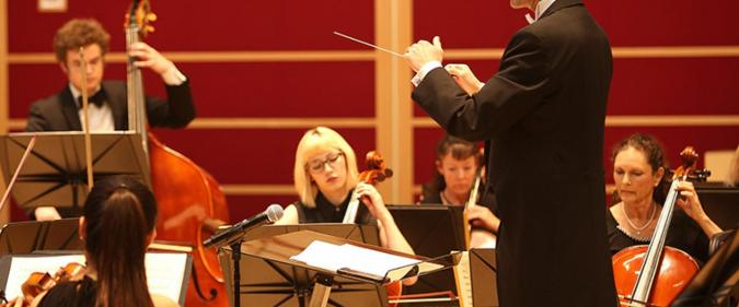 Conductor with Orchestra