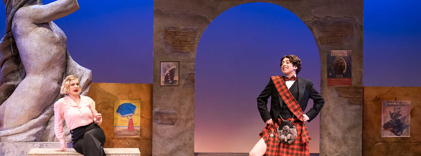 "stage production of ""Twelfth Night"" showing man in Scottish kilt speaking to woman seated on a bench in pink blouse and black pants"