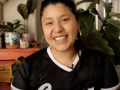 Screenshot of Noelle Dominique Rodriguez smiling in her own home